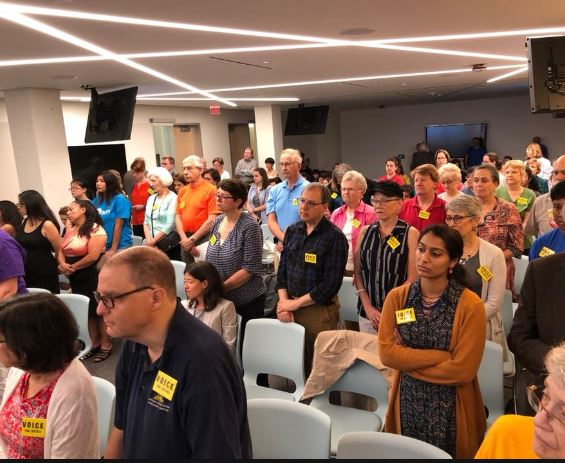photo of VOICE standing in solidarity @ APS board meeting