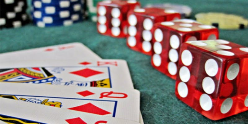 photo of playing cards & dice