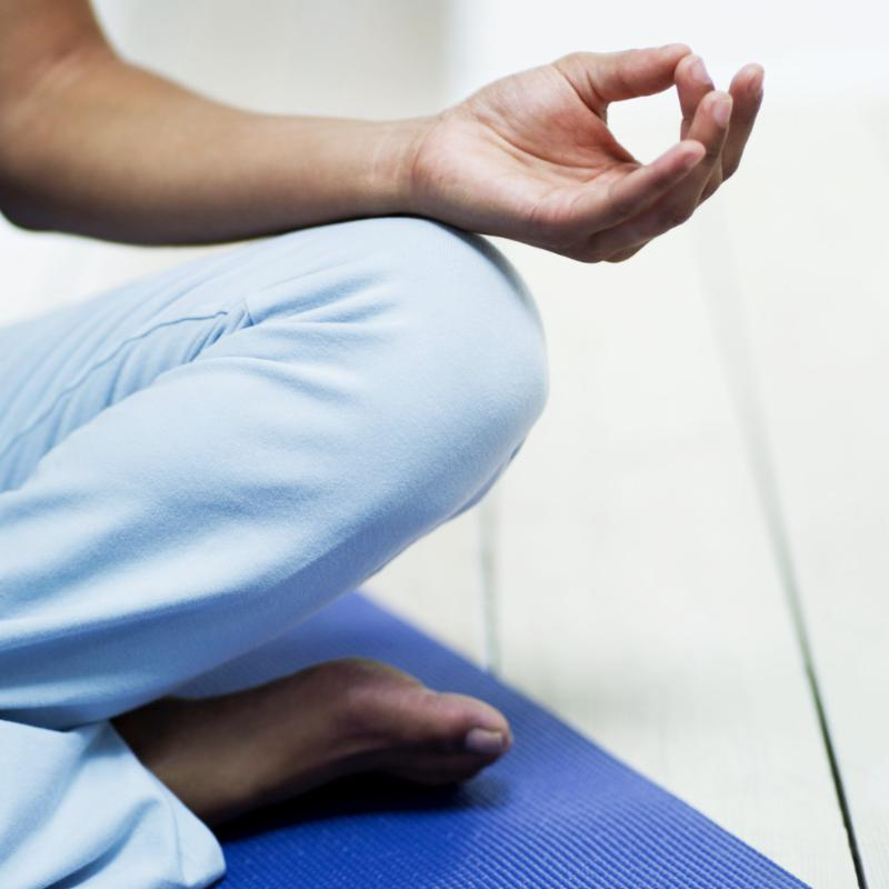 Person sitting in meditation pose
