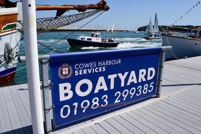 Cowes Harbour Services Boatyard banner on Trinity Landing