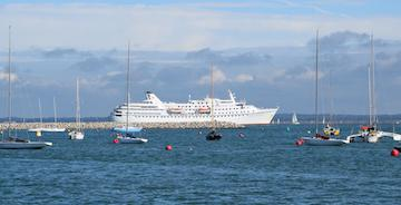 Cruise ship Ocean Majesty anchored off Cowes Harbour