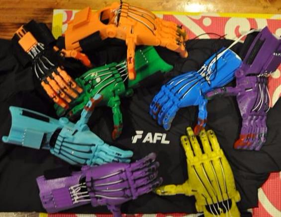 AFL Global execs assemble 3D printed hands for kids in need. VentureUp.com .