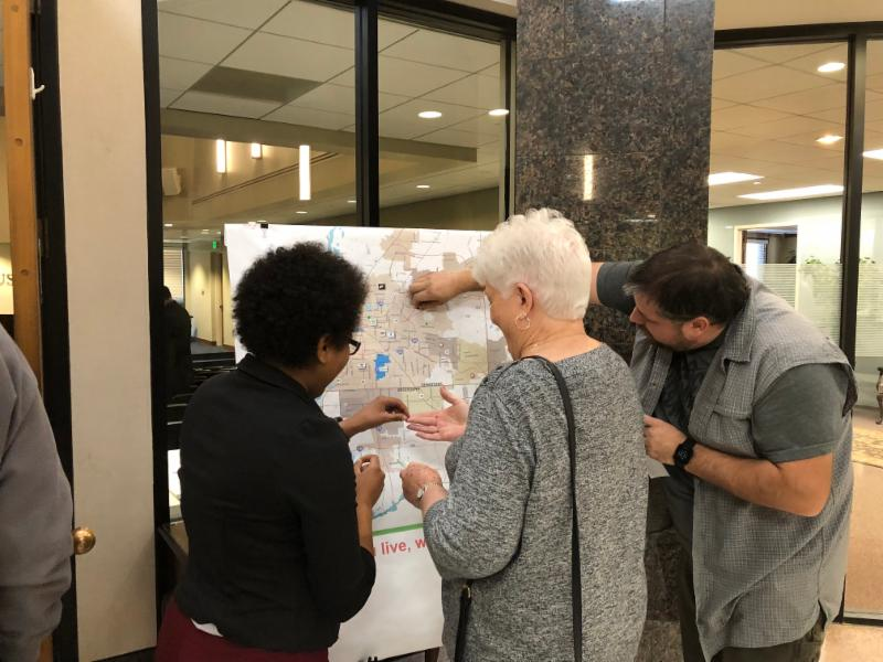 Bartlett Public Meeting: Participants place sticker on a map of the region showing where they live, work, and play.