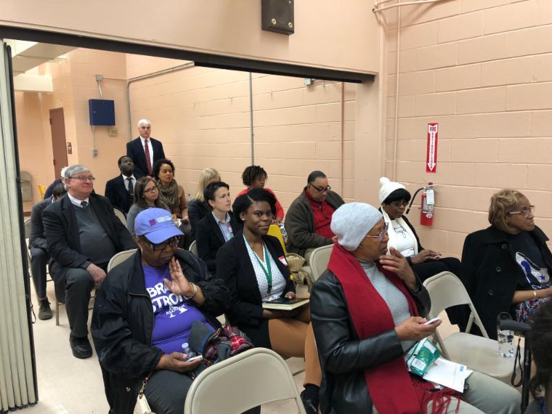 Memphis Public Meeting - Orange Mound Community Center: Participants seated auditorium style answer survey questions using live polling clickers.