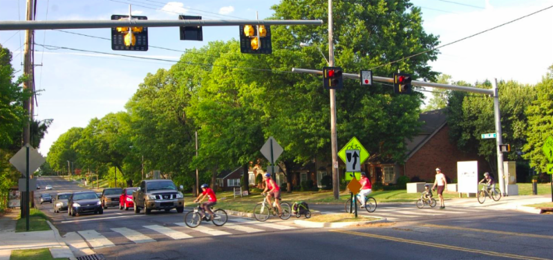 bicyclists crossing an intersection