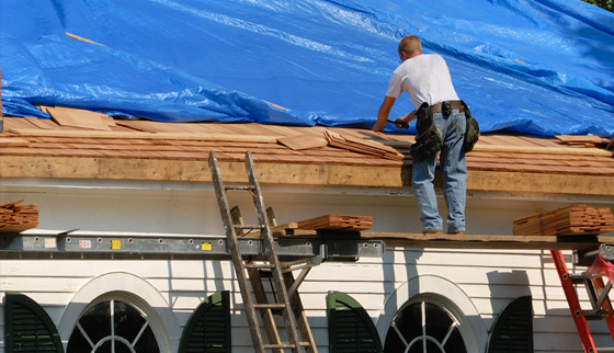 Photo of a worker repairing a church roof