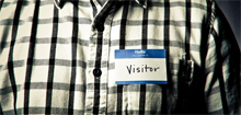 Photo of a _Hello_ My Name Is.._ tag with _Visitor_ written in