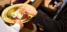 Photo of an offering plate being passed at church