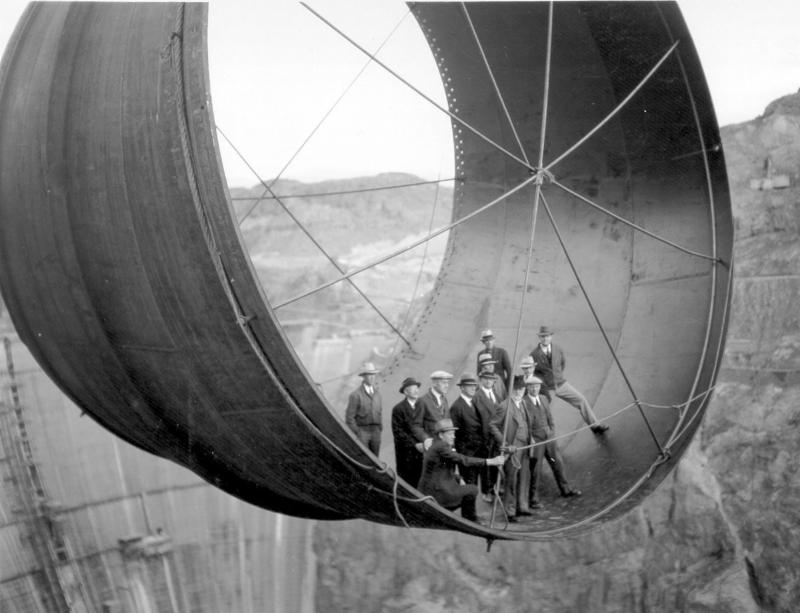 Officials ride in one of the dam_s penstock pipes _1935_.