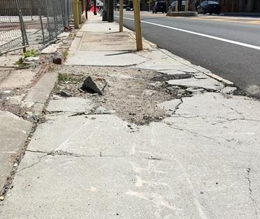 Broken sidewalk on Edgewood adjacent to resurfaced street