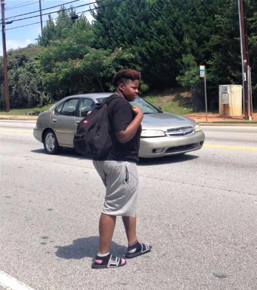 Woman crossing Covington Highway