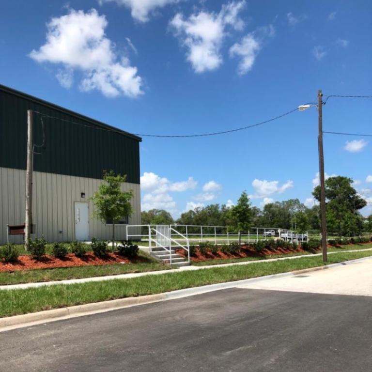Photo showing example of landscaping for new pallet company