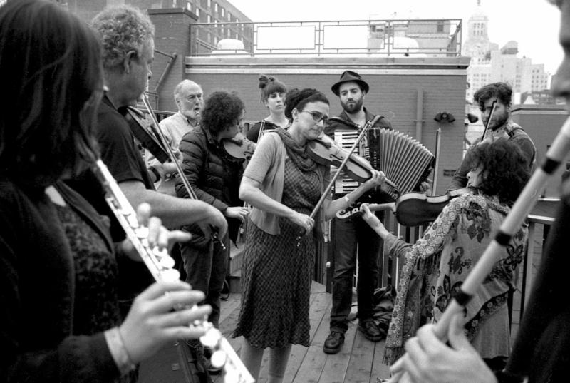Violinist Deborah Strauss leads an ensemble on the roof of the 14th Street Y at Yiddish New York_s 2015 festival.