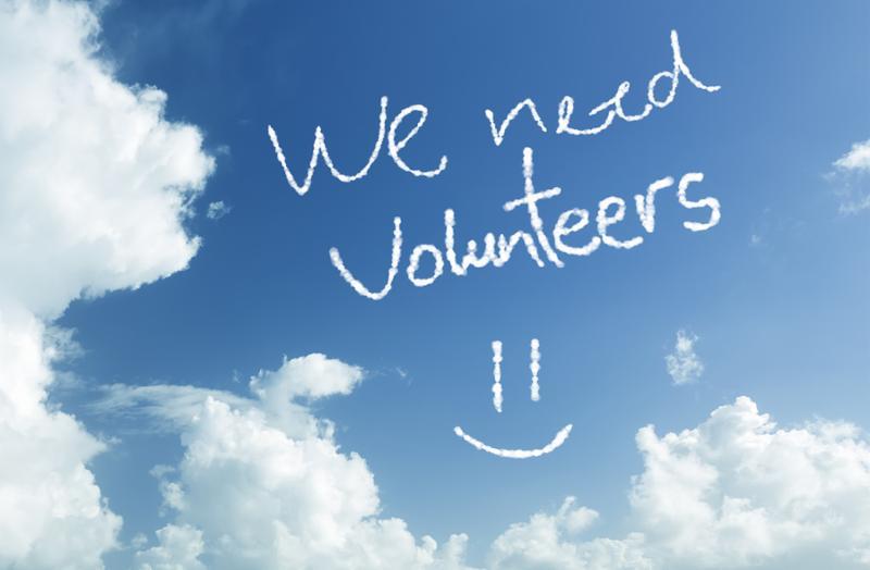 We Need Volunteers written in the sky