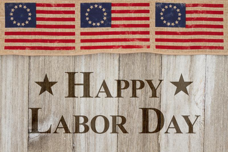 Happy Labor Day Greeting_ USA patriotic old flag on a weathered wood background with text Happy Labor Day