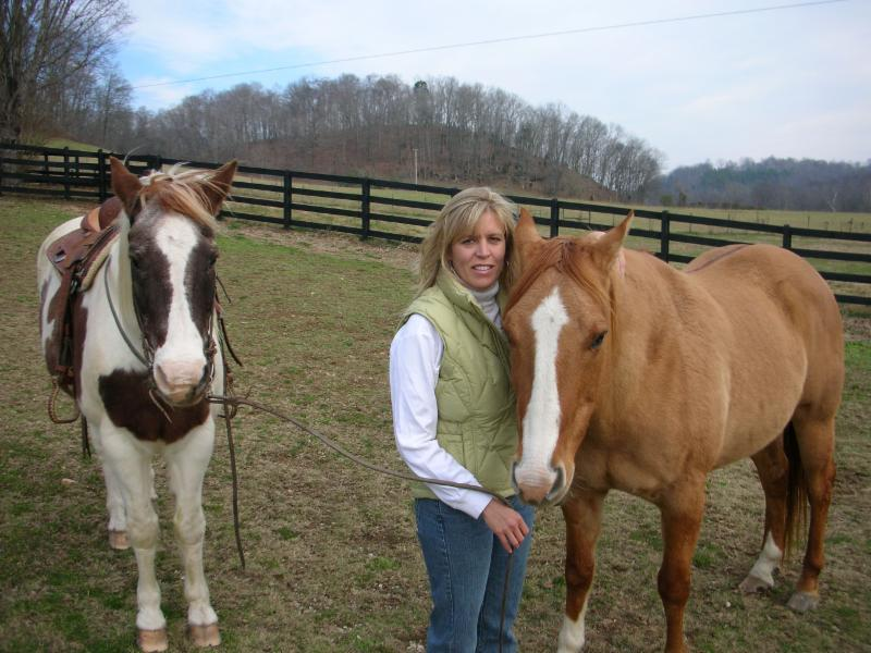 Nancy Quigley, exercise physiologist, health coach, and personal trainer, with her horses.