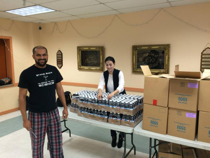 Photo of Khurram Ahmed and Sarah Ali at the food pantry
