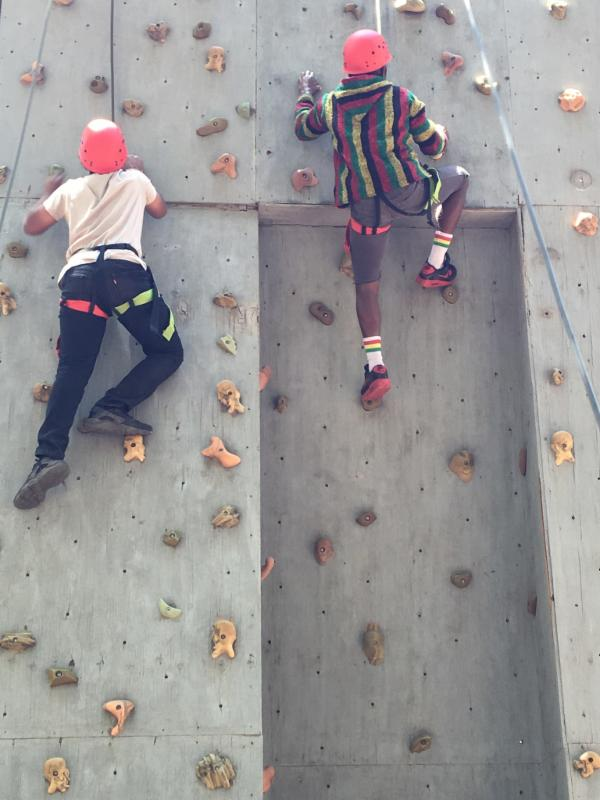 Photo of Friday PrayersMYG kids scaling the rock wall at their Ropes Course last Saturday_ May 21