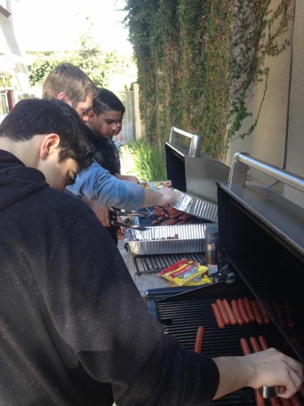 Photo of MYG grilling hot dogs for Ronald McDonald House