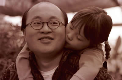 father-daughter-kiss.jpg
