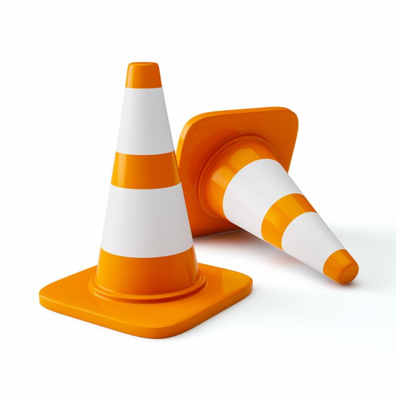 Under construction concept design background - orange highway traffic construction cones with white stripes isolated on white