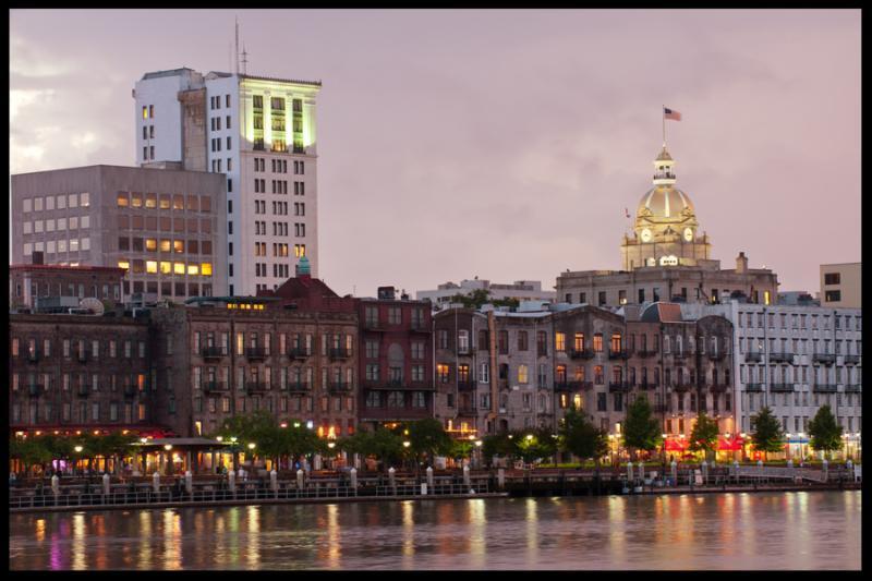 Illuminated waterfront Savannah Historic District at night