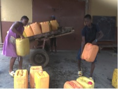 2017 Kids carry water prior to water deliveries