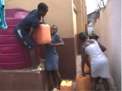 2017 Kids carrying water prior to delivery