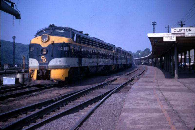 E8 No. 4000 heads up Train No. 4, the eastbound Sportsman, as it pauses at the Clifton Forge depot on June, 1967. The platform canopy to the right was built ...