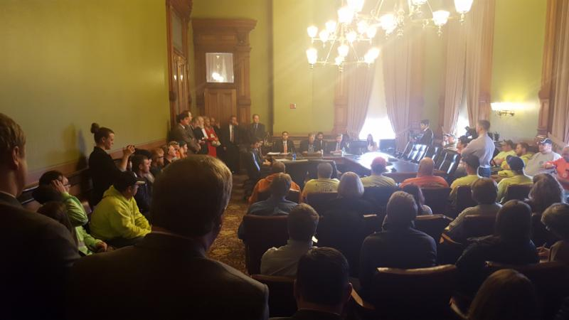 Room 116 of the Capitol_ packed during a subcommittee meeting on Worker Comp legislation.