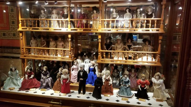 The First Spouse Doll Display Case in the South Hallway of the First Floor of the Iowa State Capitol.  In the center stands the new doll representing the First Gentleman_ Kevin Reynolds
