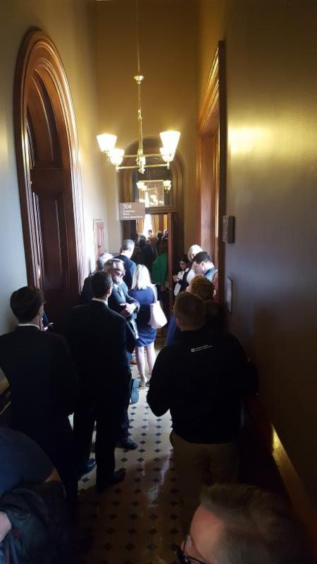 A subcommittee on a bill to get rid of several boards and commissions drew so many attendees that over 50 people crowded the hallway never able to enter the room.