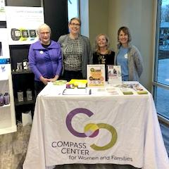 Compass Center employees gathered at Fleet Feet for the Fun Run event