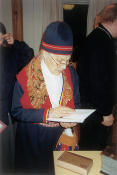 An elderly Lule Sami woman reading the NT in 2003.jpg