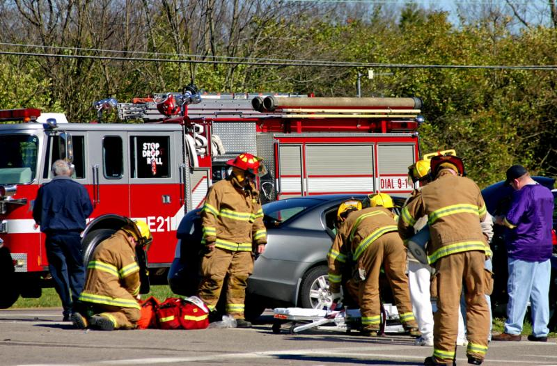 fire fighters at work on the scene of accident