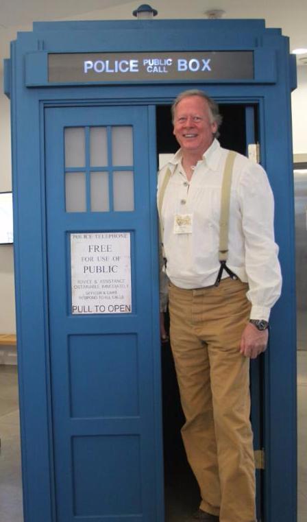 Dick Spiess poses next to the TARDIS