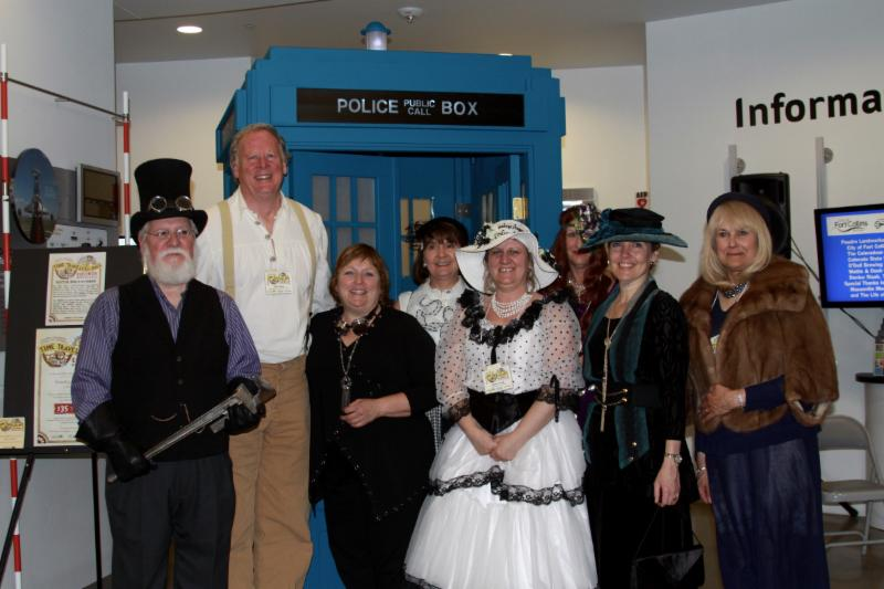 Guests pose with TARDIS at Time Travelers Ball