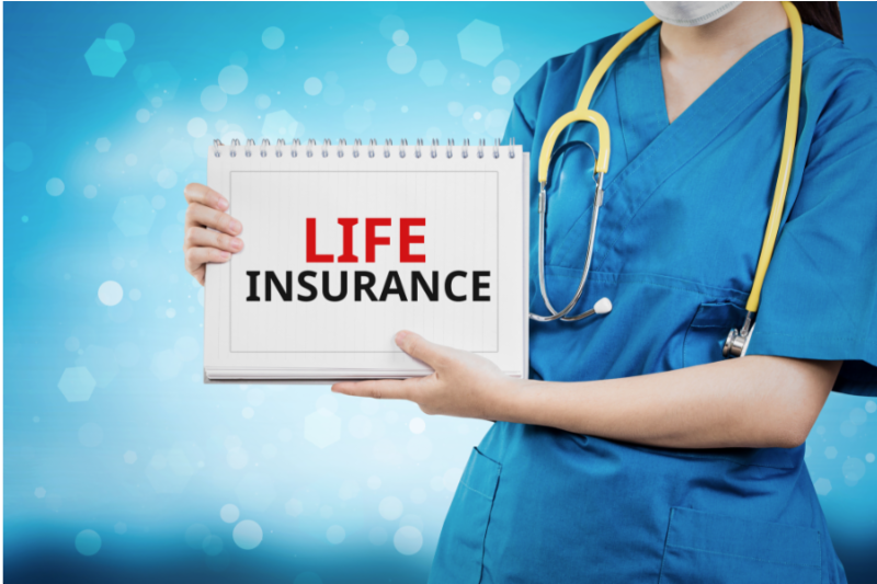 Doctor holding sign Life Insurance