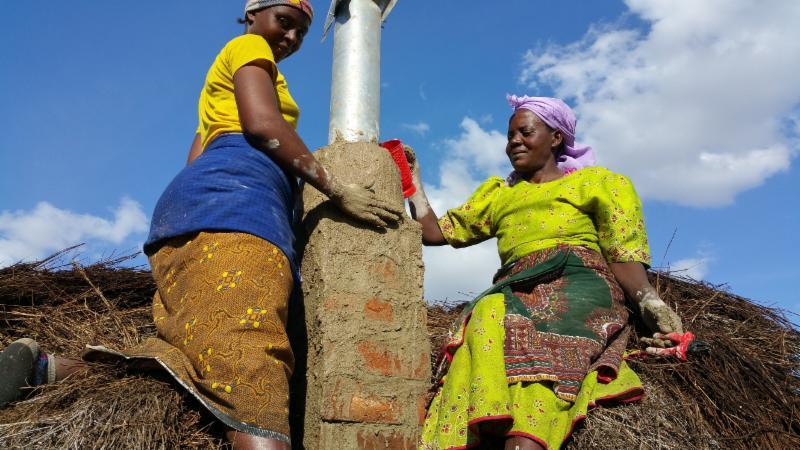 Chimney installation Maasai Stoves _ Solar