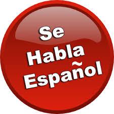 A red Se Habla Espanol sign.