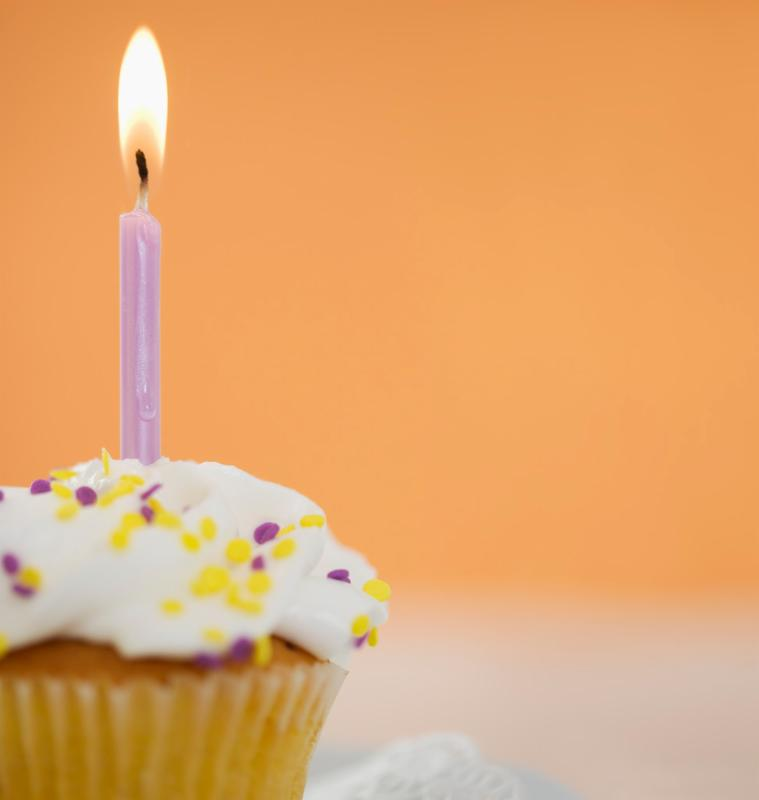 An image of a cupcake with a candle.