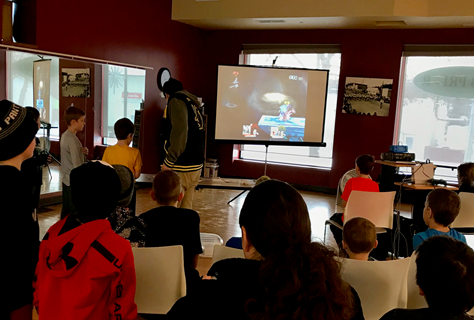 Kids watching a gaming tournament on a screen