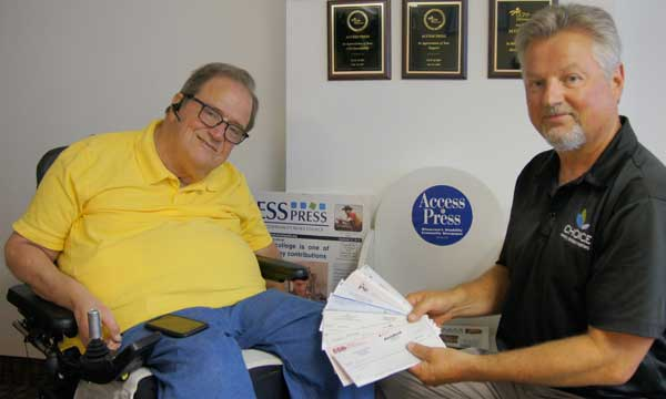 Access Press Editor-in-chief Tim Benjamin receives 10 checks from MOHR members presented by Michael Kraines, executive director of CHOICE, Inc.