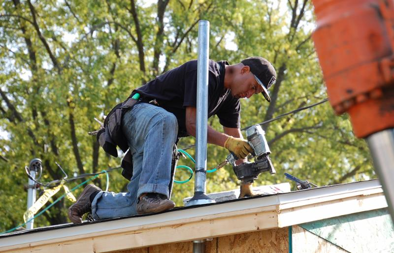 Francisco Valdez Installs Roofing On A Home Addition In The 1500 Block Of Alameda