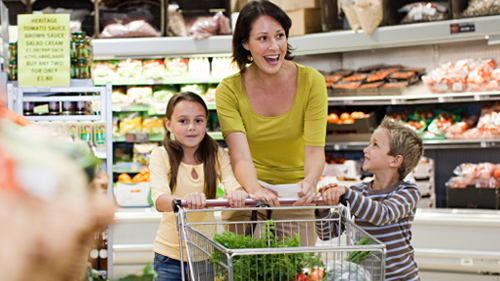 adult female with 2 children in grocery store