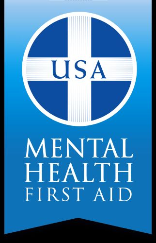 Mental Health First Aid logo with USA in the center of a white cross on a blue circle on a banner shaped lighter blue background