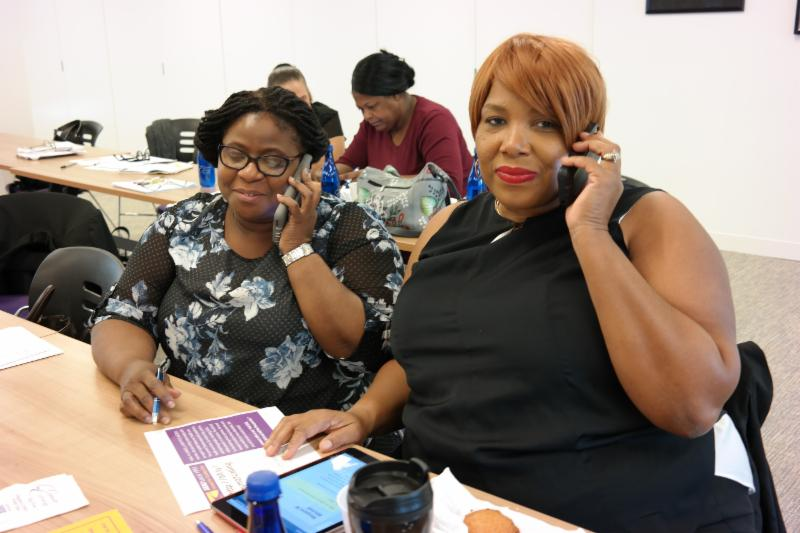 Marie Eloi, Med-Tech, and Maggie Pena Vancol, MSW, phonebanking to save healthcare.