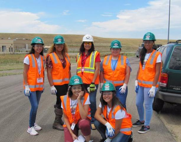 Young women in transportation and construction.