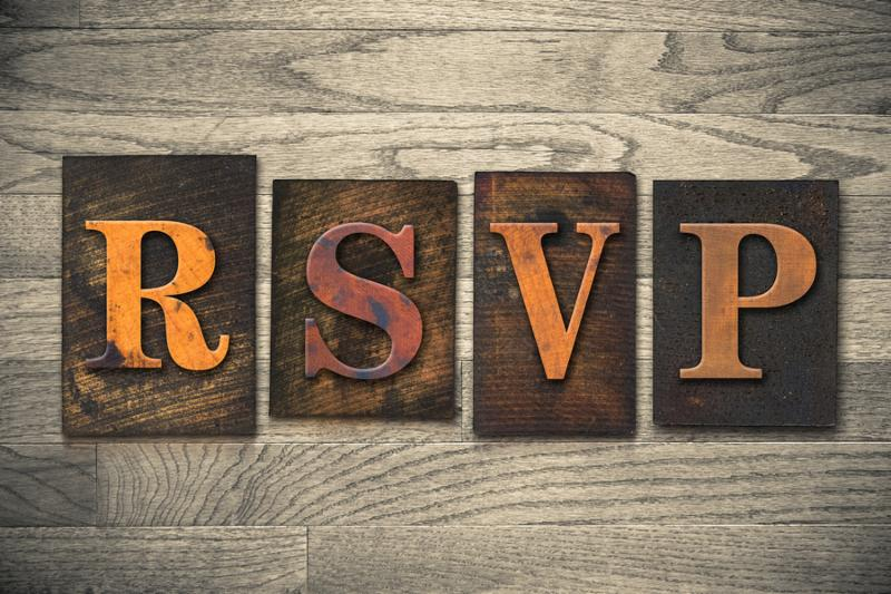 The word  RSVP  written in vintage wooden letterpress type.