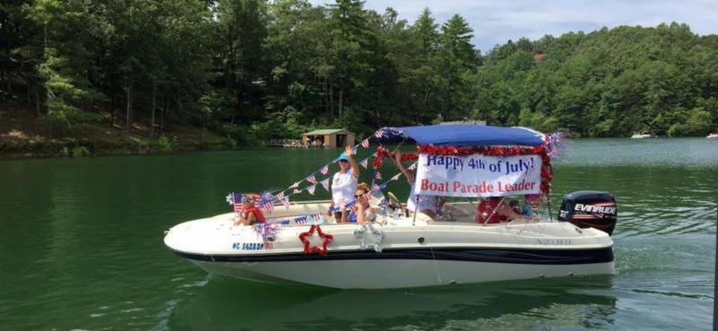 Festive boat leading boat parade on Hiwassee Lake.